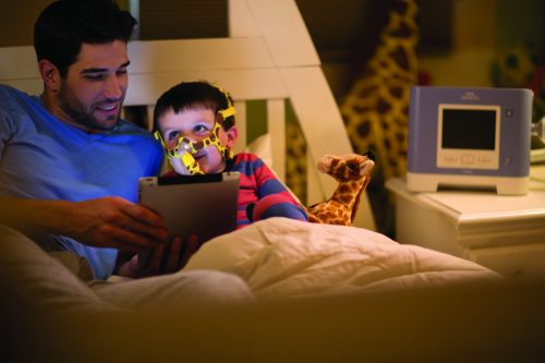 Wisp+Pediatric+with+Trilogy,+Child+and+Dad+with+Tablet+in+Bed+Hi+Res